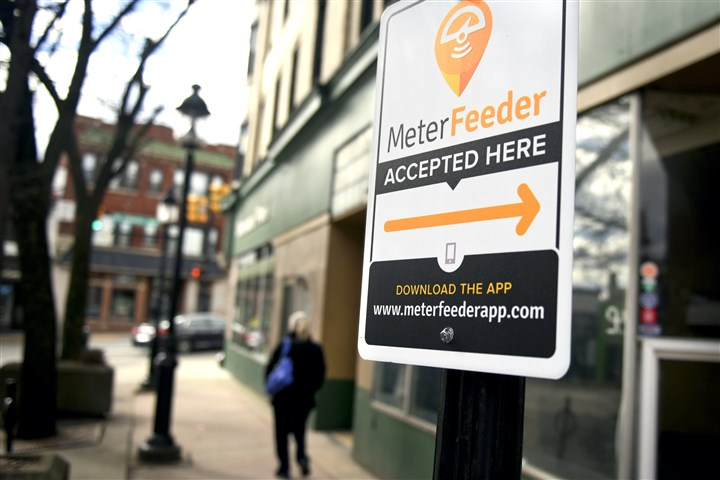 20150331smlocaldormont001 New signs in Dormont, including this one on Potomac Avenue, urge motorists to use a parking app on their smart phones to pay for and manage their parking in the borough.
