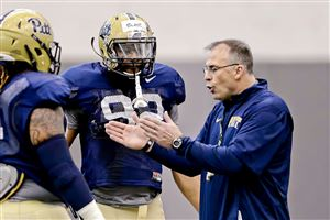 Pitt coach Pat Narduzzi coaches Rori Blair in spring practice Tuesday on the South Side.
