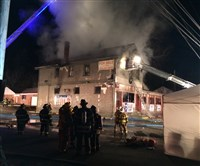 Firefighters work to extinguish a three-alarm blaze at the Olde Large Hotel restaurant in Jefferson Hills this morning.