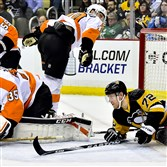Patric Hornqvist slides in to the Flyers goal Wednesday night.