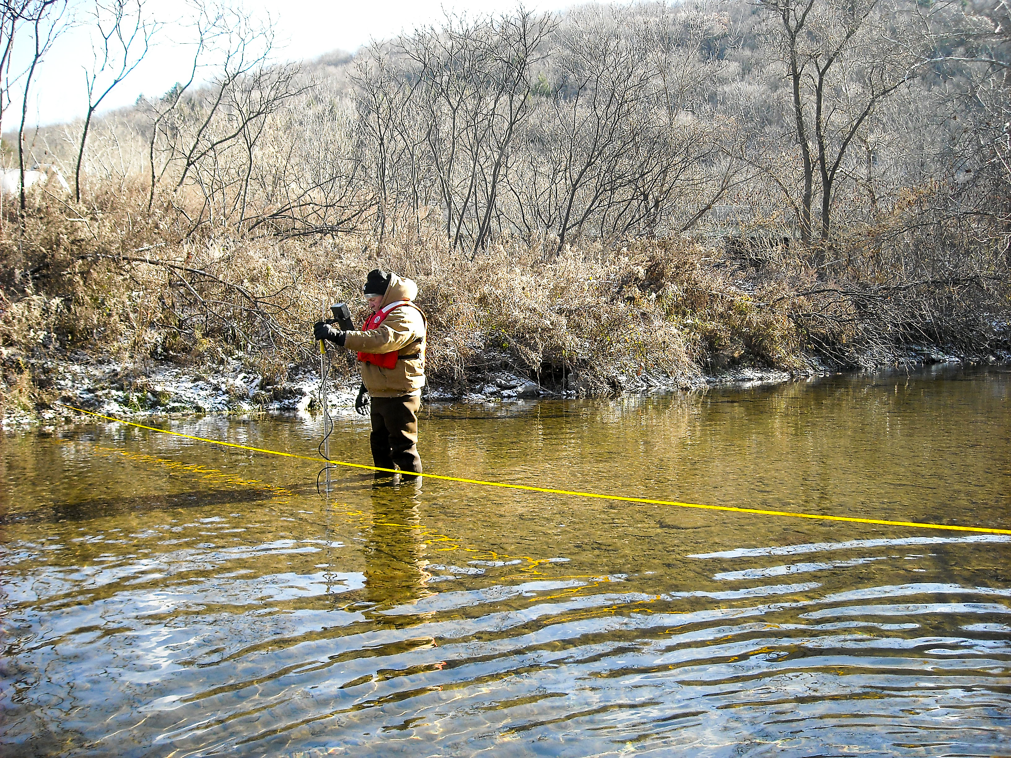 20150407hoMethane_1-1 Randall Conger, a hydrologist from the U.S. Geological Survey, takes measurements in Nine Partners Creek in northeastern Pennsylvania as part of a study of methane levels in streams near natural gas development areas.