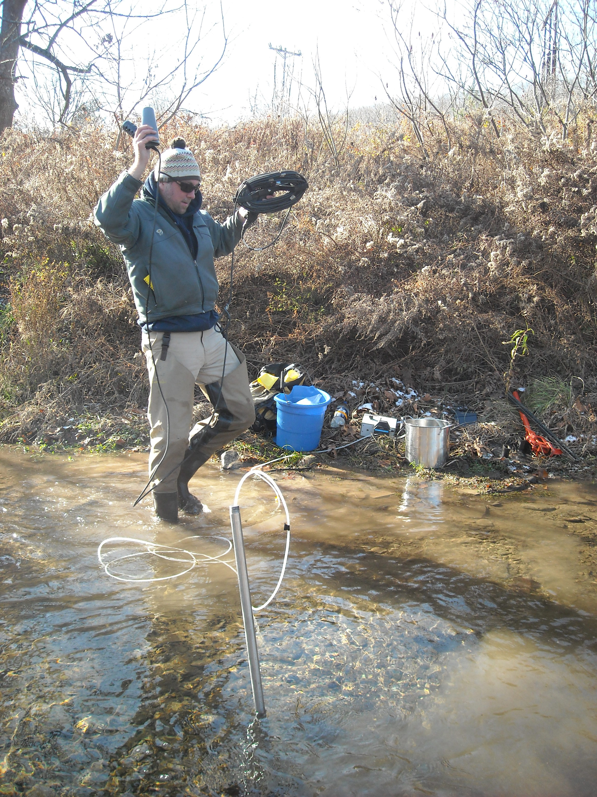 20150407hoMethane Researchers with the U.S. Geological Survey and Penn State are studying streams that run through areas of gas development to detect the migration of gases through aquifers. Scott Hynek, a post-doctoral researcher at Penn State, takes measurements in Nine Partners Creek in northeastern Pennsylvania.