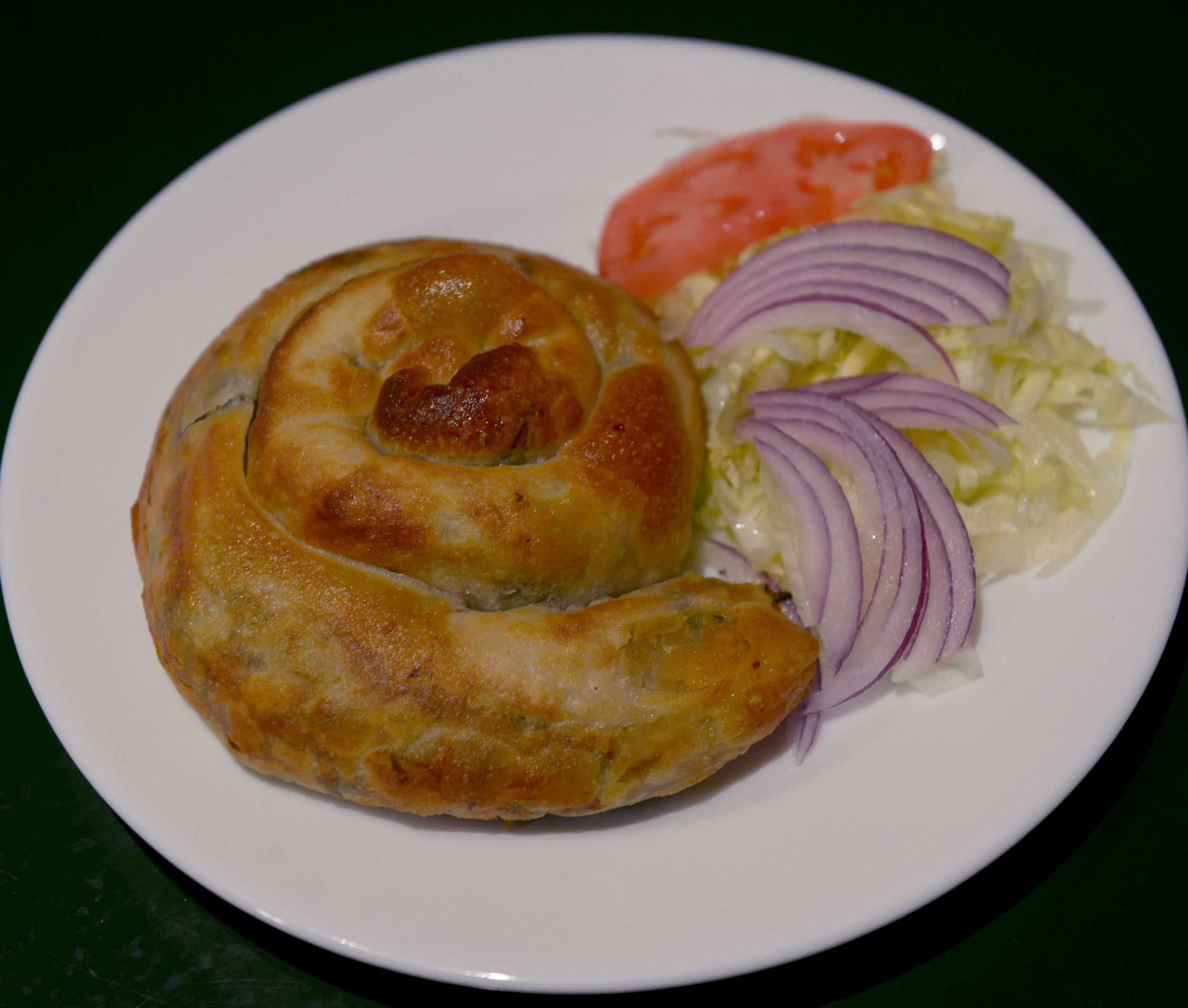 20150403ppTABLE0409WKNMAG3-2 A Spinach and Feta Pita Swirl prepared at Fredos Market, Deli & Catering in Dormont.