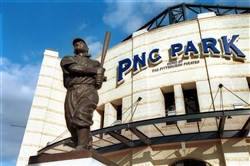The statue of Honus Wagner dominates the view of PNC Park from the corner of General Robinson Boulevard and Mazeroski Way.