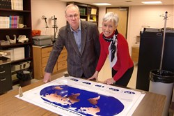 Nina Jablonski  and her husband and collaborator, George Chaplin, go over their map of predicted skin color.