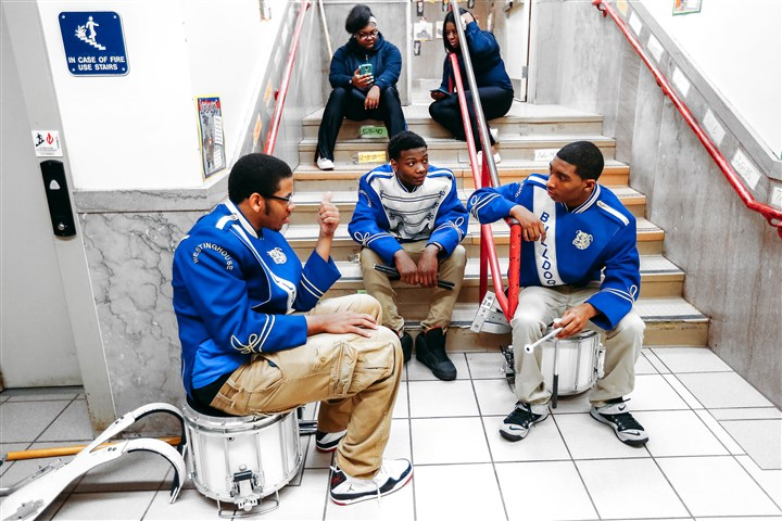 20150407ARPghLincoln3-2 Members of the Westinghouse marching band, from left, Kevin Tyler, Louis Doby, and Robert Rose-Thompson, take a break after performing during an assembly at Pittsburgh Lincoln elementary school that celebrated the school's STAR status.