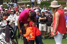 While on the practice area for the 2015 Masters at Augusta National Golf Course, golfer Tiger Woods of the U.S. gets a hug from his daughter Sam and son Charlie as girlfriend Lindsey Vonn looks on in Augusta, Georgia in this still image taken from an April 7, 2015 video.