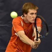 Latrobe's Chad Kissell backhands the ball against Canon-McMillan's Chris Gladden during the 2015 WPIAL AAA Boys Singles Tennis Championship at the Racquet Club in Monroeville.