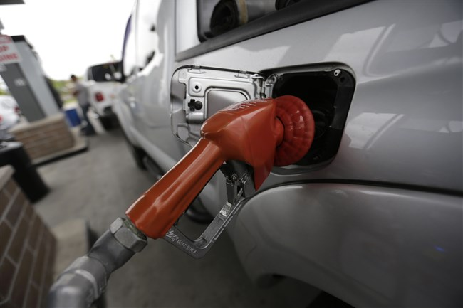 A vehicle is refueled at a gas station in New Orleans on Monday, April 6, 2015.