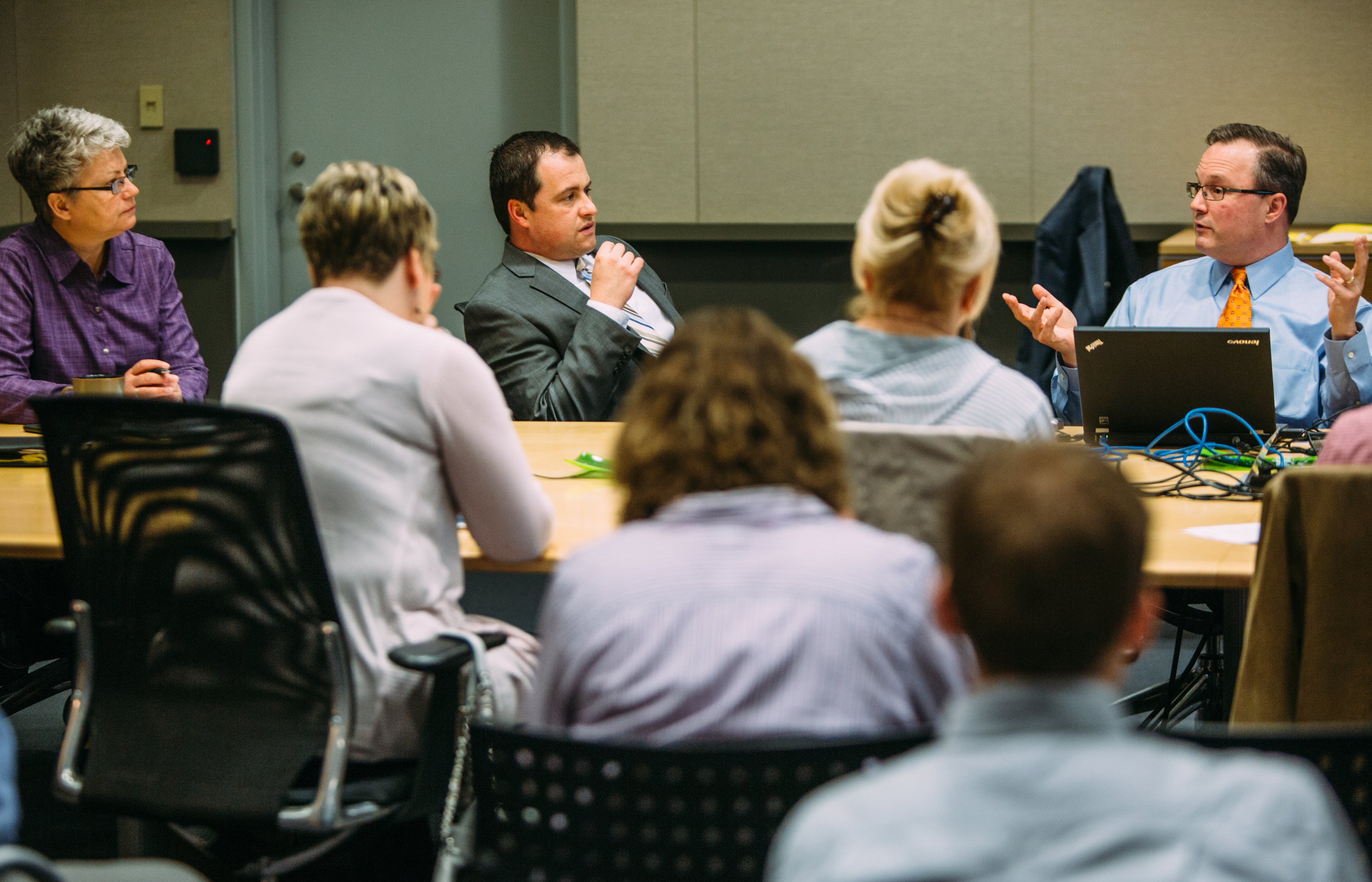 20150408ARElectricAuctionBusiness3-2 Jon Harvey of EnerNOC, far right, talks with Jim Sloss, deputy director of innovation and performance for the City of Pittsburgh, and Jackie Vincunas, CFO of the Pittsburgh Zoo & PPG Aquarium during a meeting of local utility managers at the David L. Lawrence Convention Center on Wednesday.