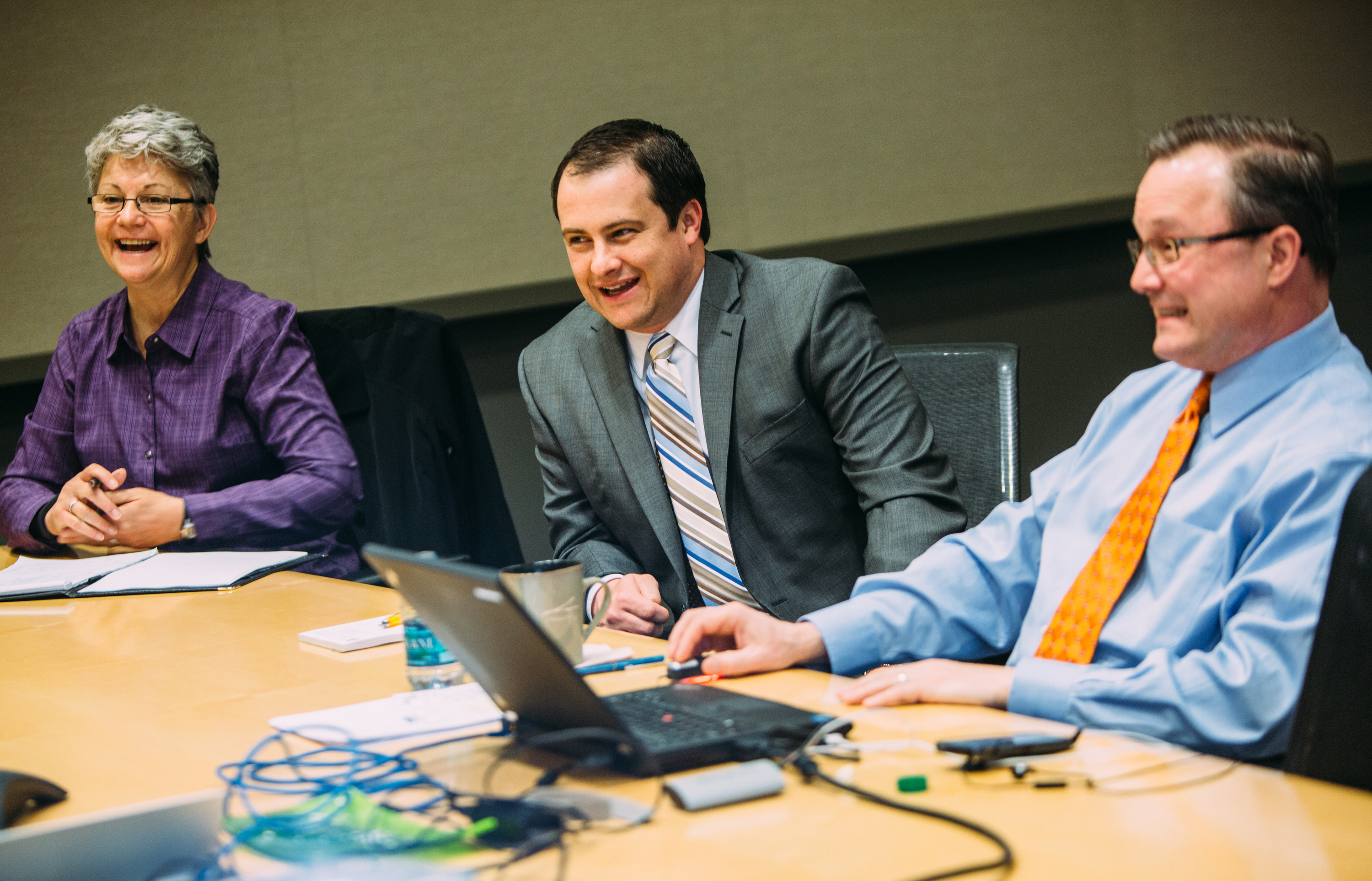20150408ARElectricAuctionBusiness4-3 Jackie Vincunas, CFO of the Pittsburgh Zoo & PPG Aquarium, Jim Sloss, deputy director of innovation and performance for the City of Pittsburgh, and Jon Harvey of EnerNOC, talk as online bids come in from five electric supply companies during a meeting of local utility managers at the David L. Lawrence Convention Center on Wednesday. The Western Pennsylvania Energy Consortium, which combines the electric utility accounts for more than two dozen municipal organizations in Allegheny County, including the City of Pittsburgh, agreed to purchase 30 percent of its electricity from clean sources, 5 percent more than its last auction in 2013.
