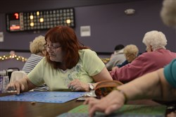 Margie Slomo of Vanport looks for a number on her boards during a bingo game at The Center at the Mall, a senior center at the Beaver Valley Mall, offering group activities along with a fitness center catering to people 50 years and older.
