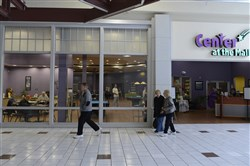 People walk by a senior activity and fitness center inside Beaver Valley Mall in 2015.