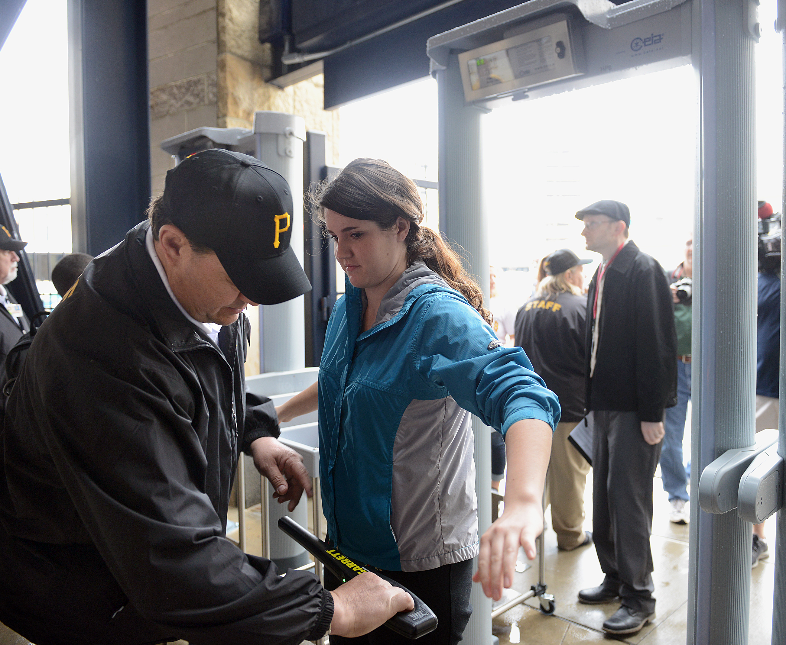 20150409radPNCParkLocal02-1 A visitor for the preseason tour at PNC Park is swept with a magnetic wand after passing through the new metal detectors.