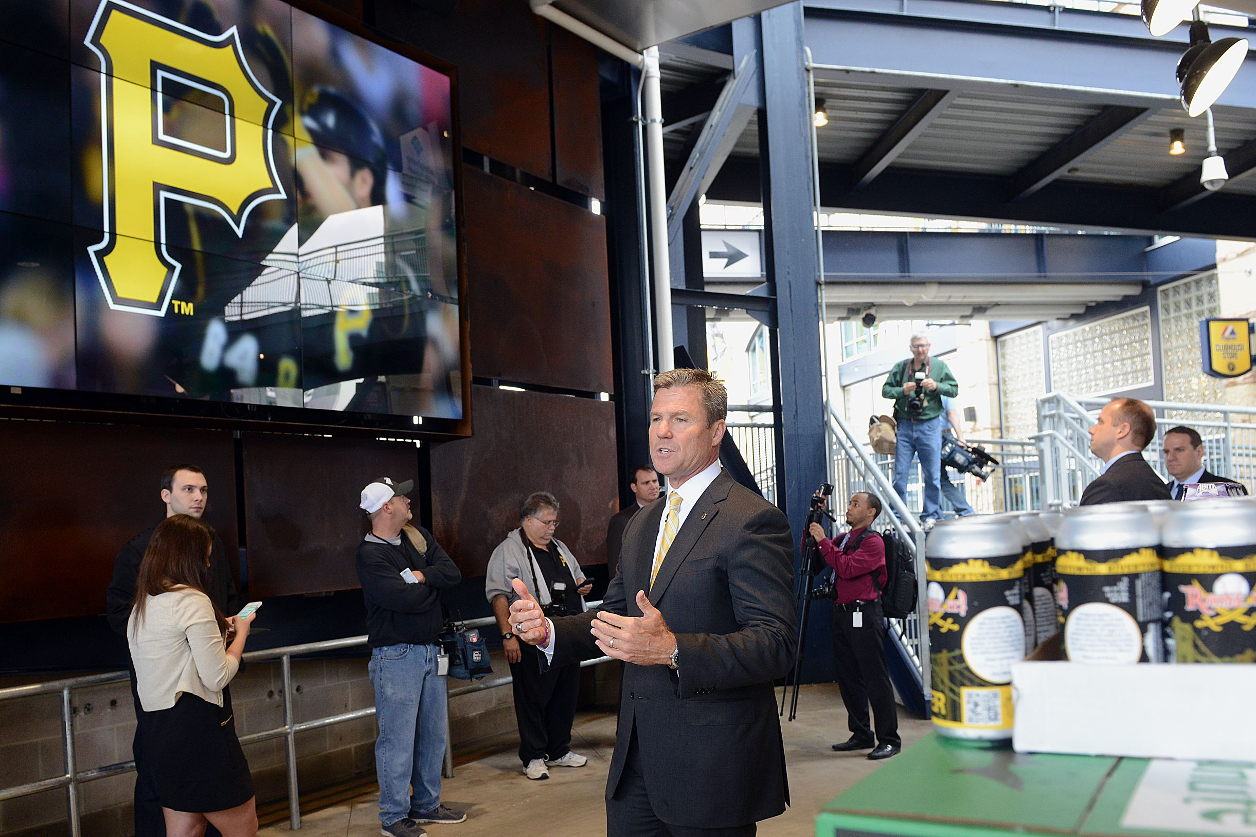 20150409radPNCParkLocal04-3 Pirates President Frank Coonley describes the Corner Bar, located under the escalators in the left field rotunda, at PNC Park. Alcohol served at the bar must be consumed in the area.