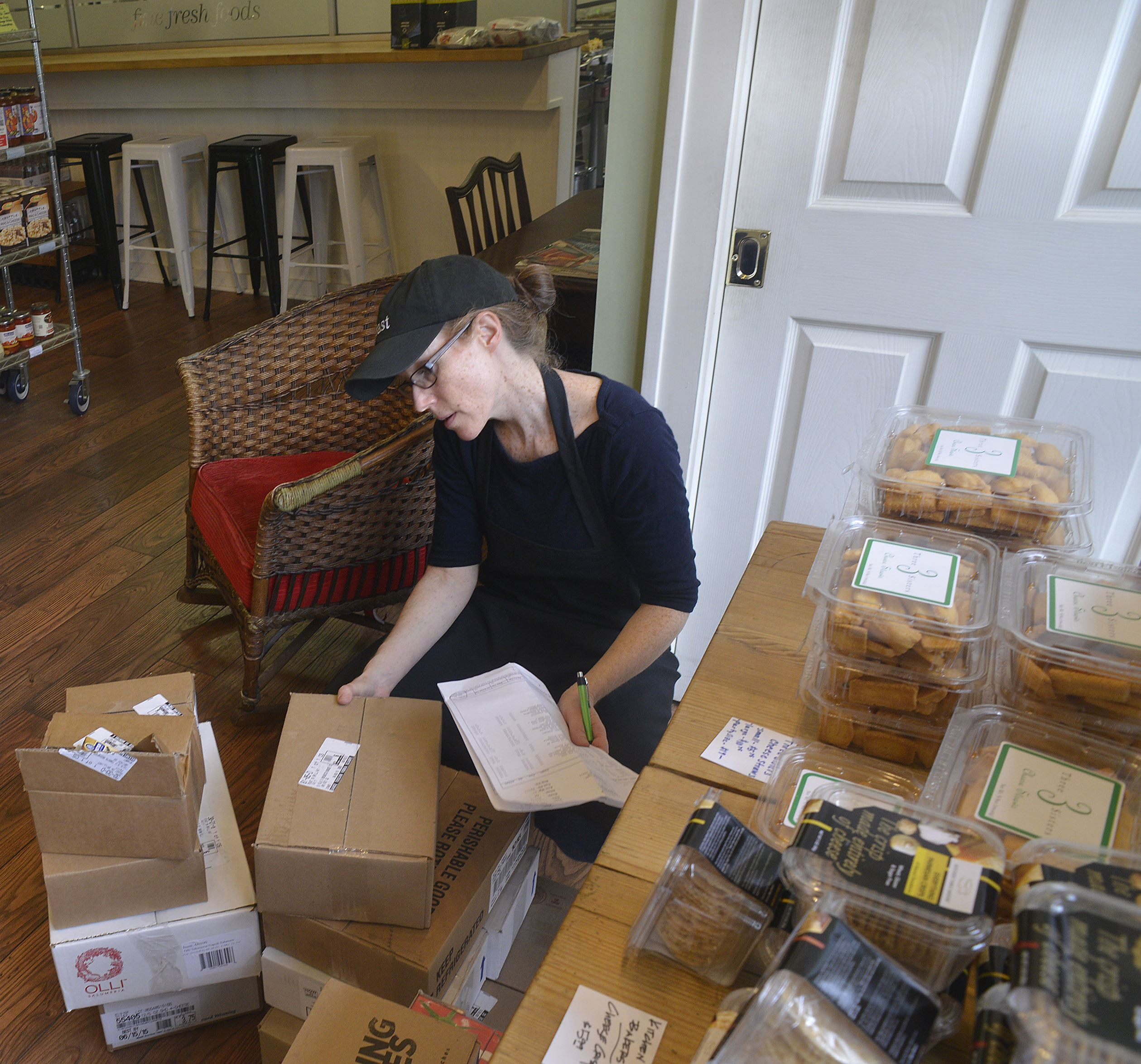 20150409lrbrilliantfood06-4 Patty Danforth , the proprietor of Feast on Brilliant in Aspinwall, checks off each of the cheeses she received in a delivery.