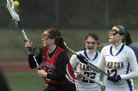 Caroline Larkin, center, a 5-foot-3 senior, is one of WPIAL's top players. She plays the attack position at Hampton.