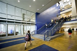 Students walk through a bright blue entryway that is part of Mt. Lebanon High School's $110 million renovation. When complete, the high school will include a fine arts wing. a STEM (science, technology, engineering and mathematics) wing, a cafeteria with a composting program and a separate aquatic and physical education building. The project is the result of years of community meetings that included planning and feedback.