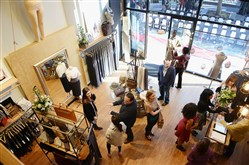 The opening reception for the Uptown Sweats by Kiya Tomlin and Sandra Cadavid boutique in East Liberty on Saturday. Outside the shop, a red carpet and seats are situated for a runway show.