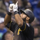 Pirates first baseman Pedro Alvarez crosses home plate after hitting a solo home run off Milwaukee starter Mike Fiers during the fourth inning Friday at Miller Park in Milwaukee.