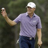 Jordan Spieth holds up his ball after putting out on the 18th hole after his second round of the Masters golf tournament Friday in Augusta, Ga. Spieth shot a 6-under 66 in the second round and is 14-under after two rounds.
