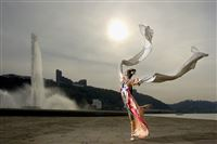Yanlai Wu in front of the Point Park fountain in her traditional Chinese dance costume.