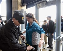 A visitor for the pre-season tour at PNC Park is swept with a magnetic wand after passing through the new metal detectors.