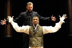 "Teagle F. Bougere as Othello (front) and Jeremy Kushnier as Iago in the Pittsburgh Public Theater production of ""Othello."""