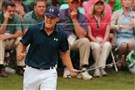 Jordan Spieth reacts to making his par putt on the 16t