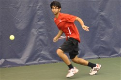 Fox Chapel Area's Sid Rajupet returns a shot during the WPIAL Class AAA singles championships.