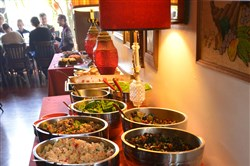 A variety of salads and vegetables line the table of the buffet at the Zenith Cafe on the South Side for Sunday brunch.
