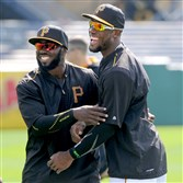 Andrew McCutchen, Josh Harrison and Starling Marte talk on the field Monday before the home opener against the Detroit Tigers at PNC Park. Marte shaved his head Wednesday, a sign of a fresh start after a slow start to the season.