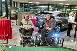 Tino Yaccich of Rochester and Keith Beatty Sr. of White Township are presented with their all-terrain Trackchairs from Rotary District 7300.