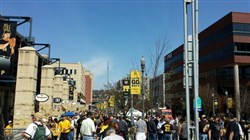 Fans gather hours before today's Pirates home opener at PNC Park on the North Shore.
