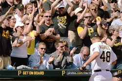 Pirates fans cheer as pitcher Jared Hughes heads to the dugout after getting the team out of a jam against the Tigers in the seventh inning Monday, April 13, 2015, at PNC Park.