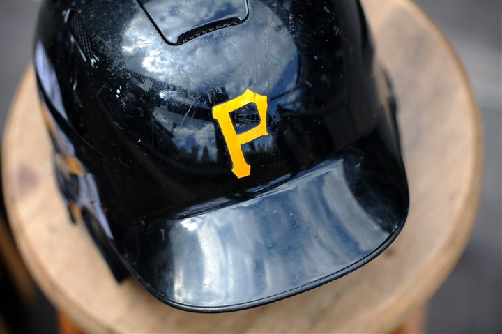 201504013rldOpeningDay13 A batting helmet sits in the dugout before the Pirates' 2015 home opener against the Detroit Tigers.