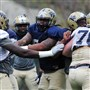 University of Pittsburgh defensive lineman Tyrique Jarrett (middle, in blue) during spring practice at the UPMC Sports Complex on the South Side Tuesday, April 14, 2015.