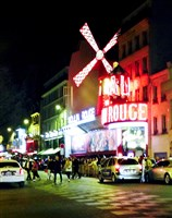 "The Moulin Rouge (literally, the ""red mill"") in Paris in the red light district on the Boulevard de Clichy."