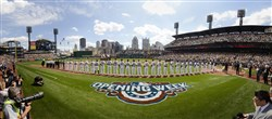 Players line up for the National Anthem shortly before the start of the Pirates' 2015 home opener Monday at PNC Park.