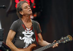 Lou Reed performs at the 2009 Lollapalooza music festival, in Chicago.  The punk-poet, rock legend, who died in 2013, will be inducted into the Rock and Roll Hall of Fame as a solo act this weekend.