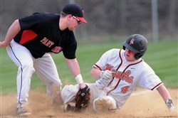 Upper St. Clair third baseman Kevin Marthinsen, left, cannot apply a tag in time as Bethel Park's Colin Loughman steals safely.