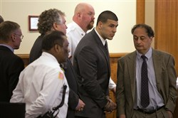 Former New England Patriots player Aaron Hernandez stands up after he was sentenced to life in prison today at the Bristol County Superior Court in Fall River, Mass.