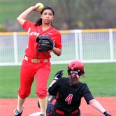 Penn Hills second baseman, Alexis Guy, left, forces out Fox Chapel's Allison Arnone, right, Tuesday.