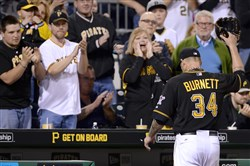 Pirates' pitcher A.J. Burnett acknowledges the crowd as he's pulled from the game in the seventh inning against the Tigers at PNC Park.