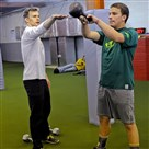 Rob Dulabon helps train Ultimate Frisbee player Micah Ziff, 15, of Fox Chapel, at his RODU gym in Larimer.