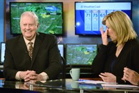 Morning anchor Jennifer Antkowiak tears up as meteorologist Dennis Bowman goes through his last morning telecast on KDKA-TV Friday.