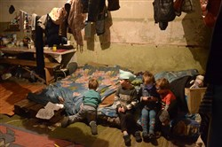 Children play inside a bomb shelter on the outskirts of Donetsk in eastern Ukraine.