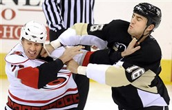 Dan LaCouture, then with the Carolina Hurricanes, and Paul Bissonnette get into a fight during a 2008 game. Mr. LaCouture is one of several former players suing the National Hockey League for allegedly failing to disclose information about the dangers of concussions and subconcussive head injuries.