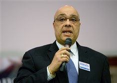 Pittsburgh Councilman Ricky V. Burgess speaks during a candidate forum Thursday at the Homewood branch of the Carnegie Library.