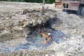 DEP regulators took this photo of a puddle of fuel on fire near an oil or gas well head during an inspection of the well site.